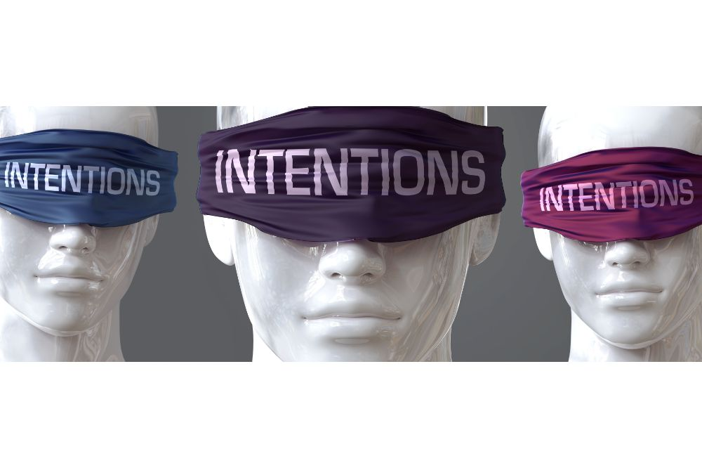pictured as word Intentions on eyes to symbolize that Intentions can distort perception of the world
