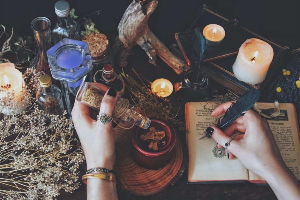 A witch casting a spell and writing it down in her Book